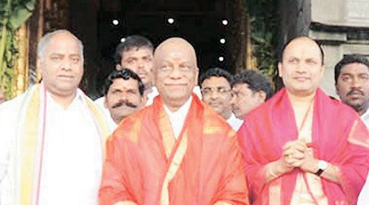 Reddy (far right in frame) next to CM O Panneerselvam at Tirupati temple.