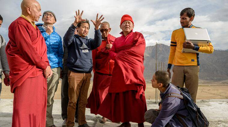 Sonam Wangchuk, His Holiness Chetsang Rinpoche (hat), Yie-Ru Chiu ( permaculture expert, blue down jacket), Suryanarayanan Balasubramanian (engineer laptop), Swati Negi (architect, women in blue jacket), and lamas at the future building site of the University.