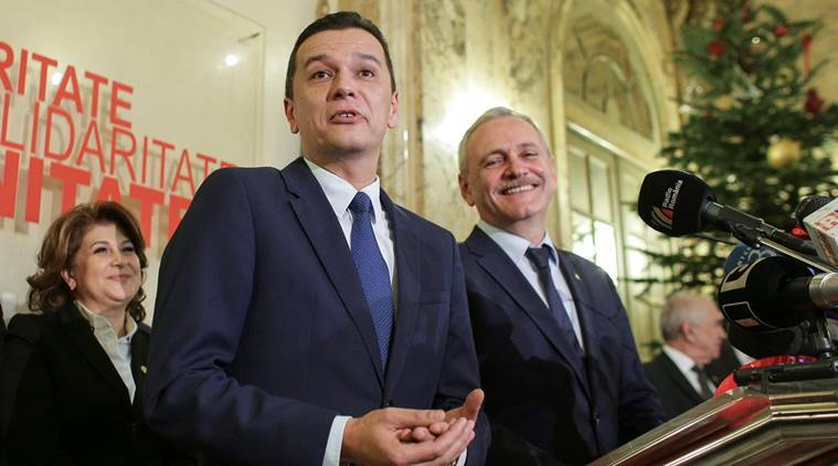 Sorin Grindeanu (C) gestures while answering a question during a press conference held alongside Romania's Social Democrat party (PSD) leader, Liviu Dragnea (R), in Bucharest, Romania December 28, 2016. Inquam Photos/Octav Ganea/via REUTERS    ATTENTION EDITORS - THIS IMAGE WAS PROVIDED BY A THIRD PARTY. EDITORIAL USE ONLY. ROMANIA OUT. NO COMMERCIAL OR EDITORIAL SALES IN ROMANIA