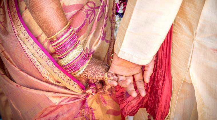 A ritual in Indian Hindu Wedding. Bride and groom holding hands.