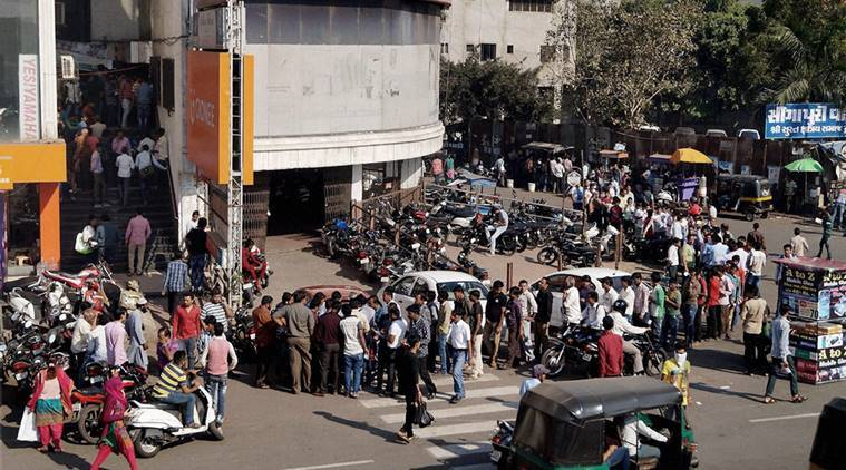 People stand in long queues to withdraw cash outside the banks in Surat. (PTI Photo)