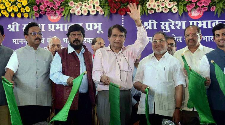 Mumbai : Railways Minister Suresh Prabhu with Social Justice & Empowerment MOS Ramdas Athawale and others flagging off various railway projects at Bandra Terminus in Mumbai on Sunday. PTI Photo (PTI12_18_2016_000149A)