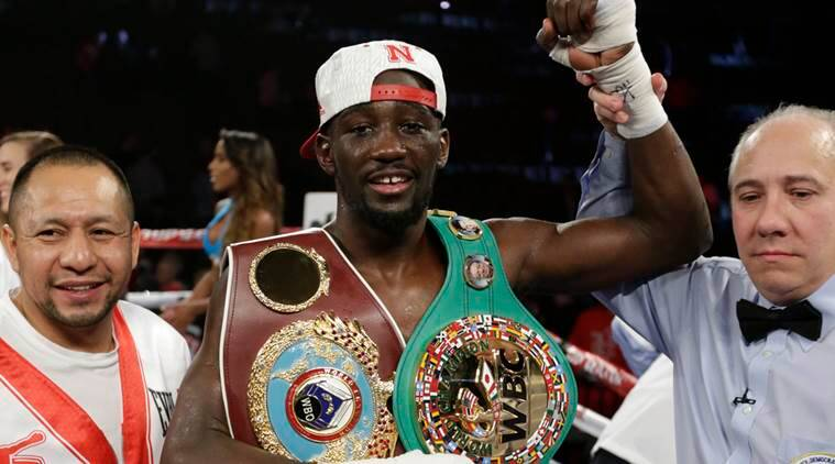 Terence 'Bud' Crawford is declared winner over John Molina Jr. after a WBO junior welterweight boxing bout at the CenturyLink Center in Omaha, Neb., Saturday, Dec. 10, 2016. Crawford won by TKO in the eighth round (AP Photo/Nati Harnik)