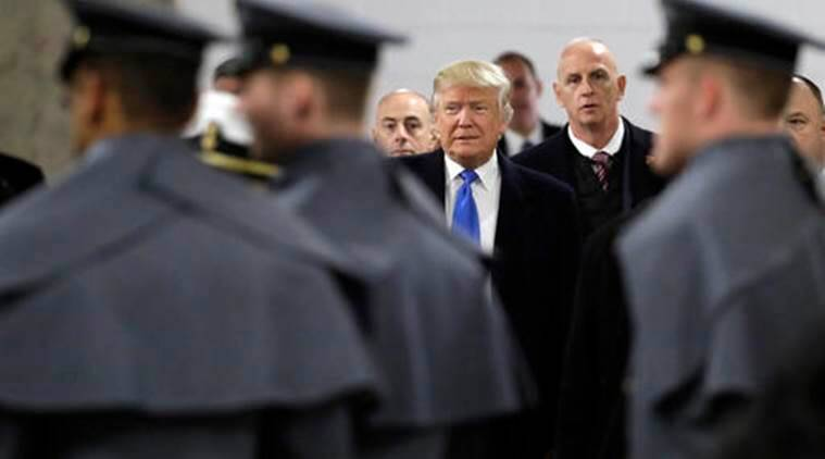President-elect Donald Trump walks up to greet Army Cadets and Navy Midshipmen before the Army-Navy NCAA college football game in Baltimore, Saturday, Dec. 10, 2016. (AP Photo/Patrick Semansky)