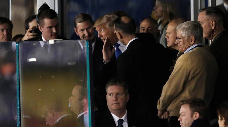 US President-elect Donald Trump stands with U.S. Navy personnel as he watches the Army vs Navy college football game at M&T Bank Stadium in Baltimore, Maryland, December 10, 2016.  REUTERS/Mike Segar