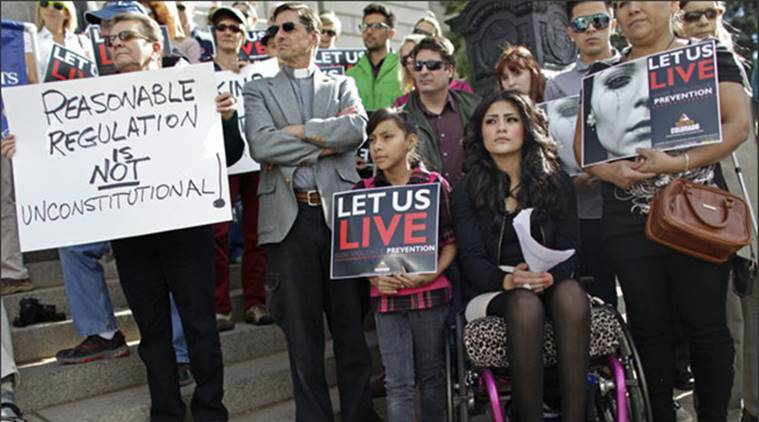 An 18-year-old who was shot in the back outside her high school in 2010,and is paralyzed from the waist down,participates in a gun control rally on the steps of the Colorado State Capitol,in Denver. (AP)