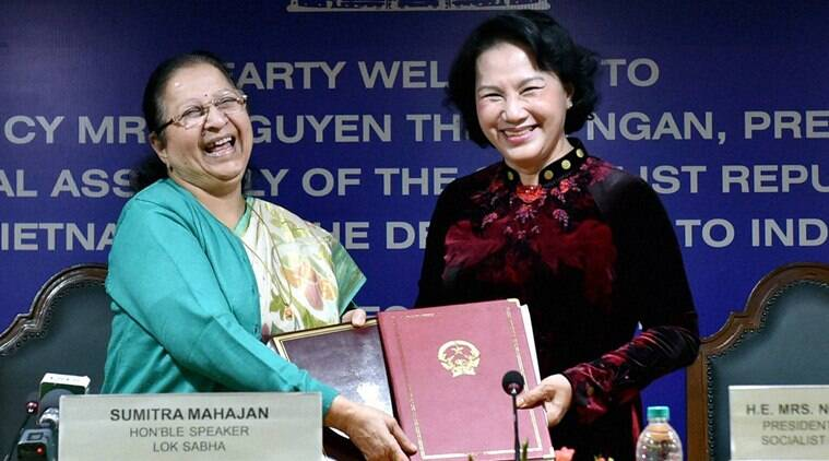 New Delhi: Lok Sabha Speaker Sumitra Mahajan and her counterpart from Vietnam, Nguyen Thi Kim Ngan exchange their documents after signing an agreement on Cooperation between Indian and Vietnamese Parliament in New Delhi on Friday. PTI Photo by Vijay Verma (PTI12_9_2016_000284B)