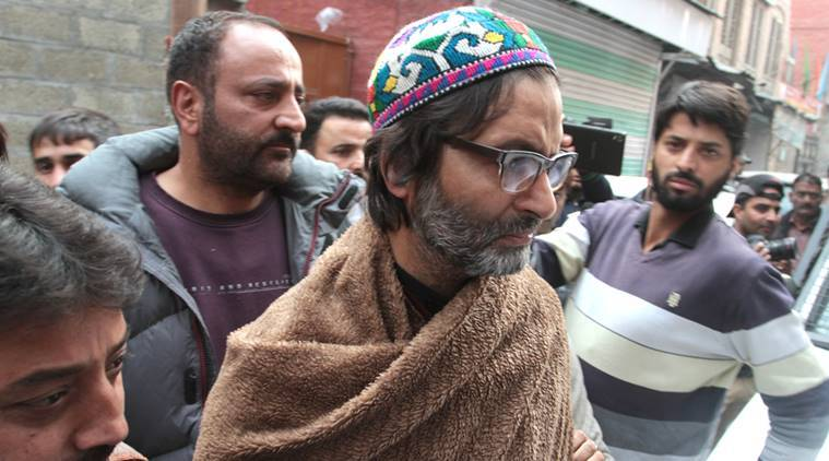 Police arrests Jammu Kashmir Liberation Front (JKLF) Chairman, Muhammad Yasin Malik from his residence at Maisuma in Srinagar on Thursday. The unified separatist leaders had called for 'Jamia Masjid March' from Thursday evening to observe Friday as the Youm-e-Istiklaal (Day of Independence). Express Photo by Shuaib Masoodi 10-11-2016