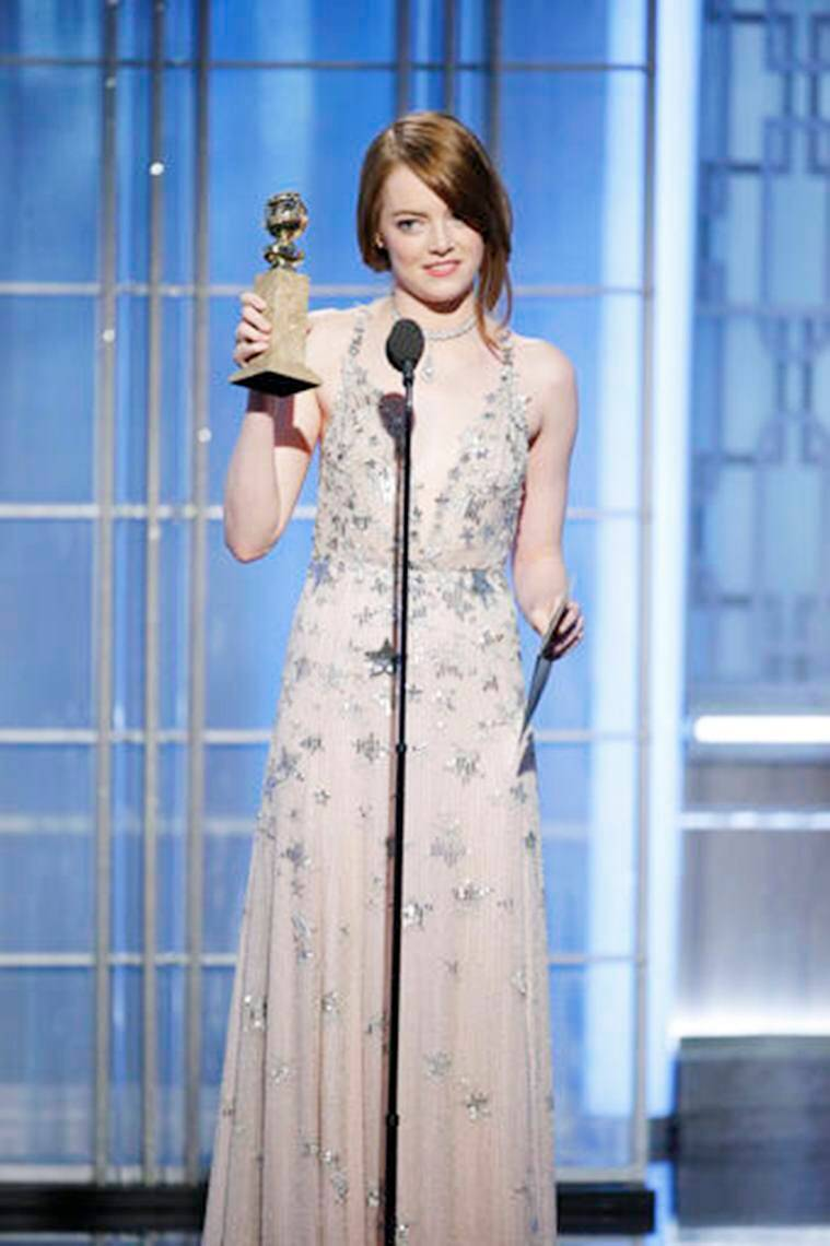 "This image released by NBC shows Emma Stone with the award for best actress in a motion picture comedy or musical for her role in ""La La Land"" at the 74th Annual Golden Globe Awards at the Beverly Hilton Hotel in Beverly Hills, Calif., on Sunday, Jan. 8, 2017. (Paul Drinkwater/NBC via AP)"
