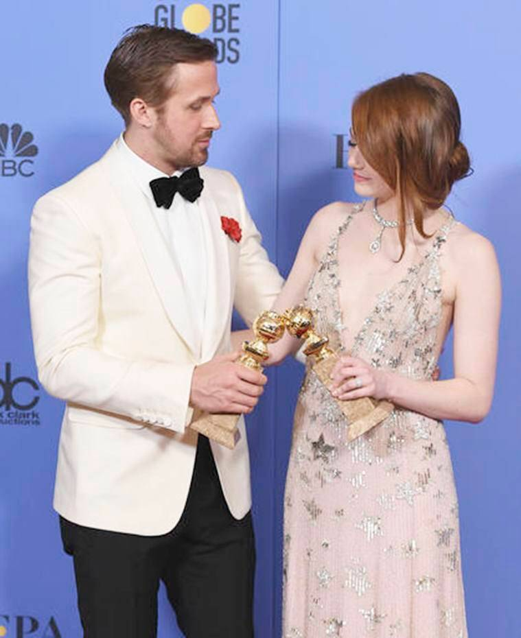 "Ryan Gosling, left, and Emma Stone pose in the press room with the award for best performance by an actor and actress in a motion picture - musical or comedy for ""La La Land"" at the 74th annual Golden Globe Awards at the Beverly Hilton Hotel on Sunday, Jan. 8, 2017, in Beverly Hills, Calif. (Photo by Jordan Strauss/Invision/AP)"
