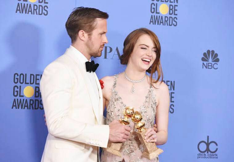 """Ryan Gosling, left, and Emma Stone pose in the press room with the award for best performance by an actor and actress in a motion picture - musical or comedy for """"La La Land"""" at the 74th annual Golden Globe Awards at the Beverly Hilton Hotel on Sunday, Jan. 8, 2017, in Beverly Hills, Calif. (Photo by Jordan Strauss/Invision/AP)"""