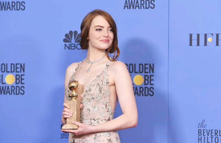 "Emma Stone poses in the press room with the award for best performance by an actress in a motion picture - musical or comedy for ""La La Land"" at the 74th annual Golden Globe Awards at the Beverly Hilton Hotel on Sunday, Jan. 8, 2017, in Beverly Hills, Calif. (Photo by Jordan Strauss/Invision/AP)"