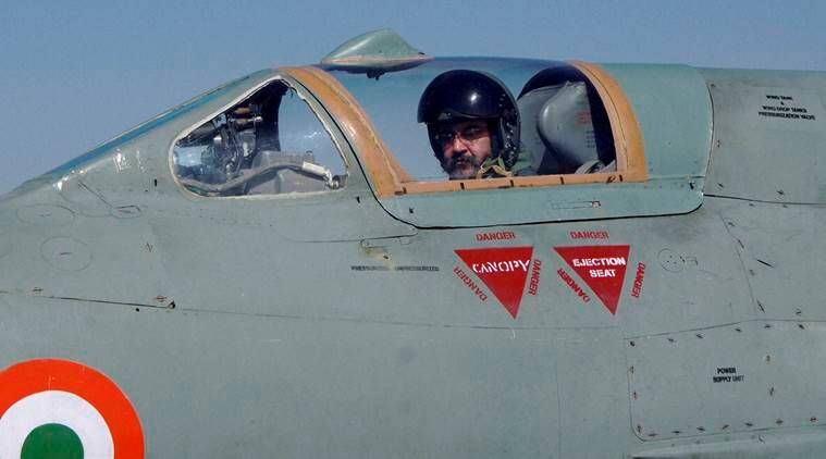 Barmer : Chief of the Air Staff, Air Chief Marshal BS Dhanoa before a MiG-21 sortie at the Forward Base in Barmer, Rajasthan on Thursday. PTI Photo (PTI1_12_2017_000211B)