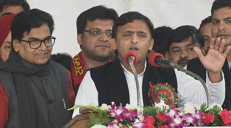 Lucknow : Uttar Pradesh Chief Minister and newly unanimously elected party's national president Akhilesh Yadav addresses as SP general secretary Ram Gopal Yadav looks on during Samajwadi party national convention in Lucknow on Sunday. PTI Photo by Nand Kumar(PTI1_1_2017_000097B)