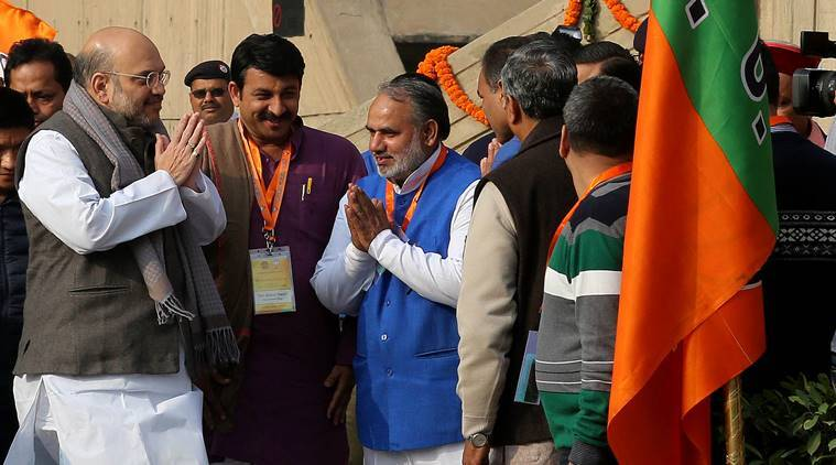 National BJP President Amit Shah with Delhi BJP president Manoj tiwari during the BJP executive meeting at NDMC convention centre in new Delhi on Friday.Express photo by Prem Nath Pandey 06 jan 17