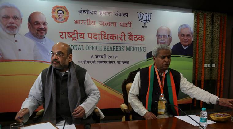 National BJP President Amit Shah with BJP Senior leader Ramlal during the BJP executive meeting at NDMC convention centre in new Delhi on Friday.Express photo by Prem Nath Pandey 06 jan 17