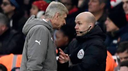 """Football Soccer Britain - Arsenal v Burnley - Premier League - Emirates Stadium - 22/1/17 Arsenal manager Arsene Wenger clashes with fourth official Anthony Taylor before being sent to the stands Reuters / Dylan Martinez Livepic EDITORIAL USE ONLY. No use with unauthorized audio, video, data, fixture lists, club/league logos or """"live"""" services. Online in-match use limited to 45 images, no video emulation. No use in betting, games or single club/league/player publications.  Please contact your account representative for further details."""