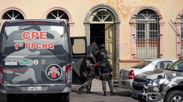Police officers enter at the public jail in Manaus where some prisoners were relocated after a deadly prison riot in Manaus, Brazil, January 6, 2017. REUTERS/Michael Dantas  EDITORIAL USE ONLY. NO RESALES. NO ARCHIVE
