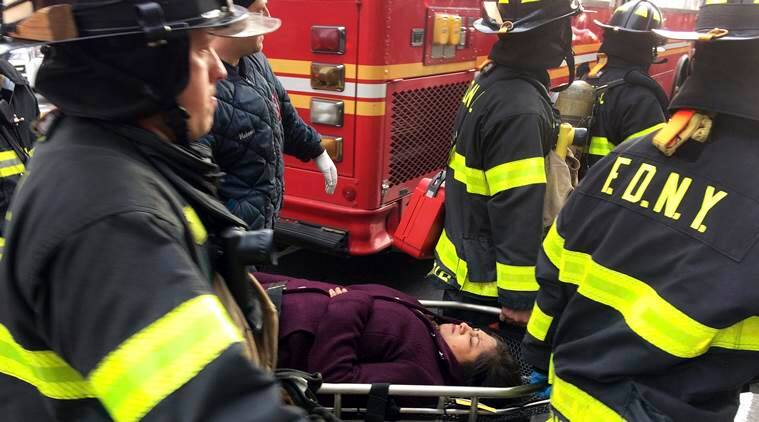An injured passenger, after a Long Island Rail Road commuter train either hit something or derailed, is taken from the Atlantic Terminal, in the Brooklyn borough of New York, Wednesday, Jan. 4, 2017. (AP Photo/Mark Lennihan)