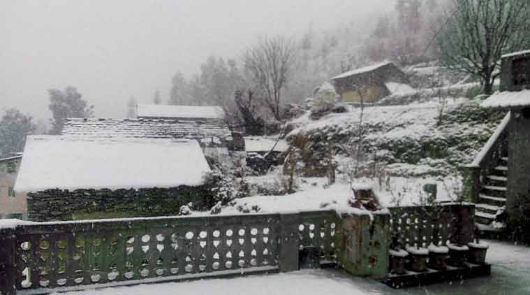 Houses draped in snow during heavy snowfall in Chamba district of Himachal Pradesh on Friday. (PTI Photo)