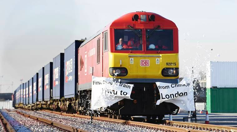 The first direct freight train service from China to the United Kingdom arrives at a rail freight terminal in Barking, east London, Wednesday Jan. 18, 2017. Some 34 containers packed with mainly clothes and other high street goods completed the 7,456-mile (11,999km) journey in 18 days. (Stefan Rousseau/PA via AP)