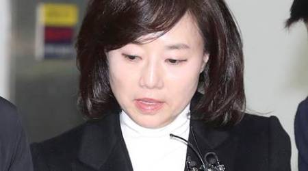 South Korean Minister of Culture, Sports and Tourism Cho Yoon-sun leaves after questioning at the office of special prosecutors in Seoul, South Korea, Wednesday, Jan. 18, 2017. Separately Wednesday, prosecutors also requested the arrest of Park's current culture minister and her former chief of staff. They gave no further details. Culture Minister Cho Yoon-sun and ex-chief of staff Kim Ki-choon were questioned by investigators earlier this week about the alleged blacklisting of artists who were critical of the Park government. Those on the blacklist were reportedly excluded from government funding. (Kim Do-hun/Yonhap via AP)