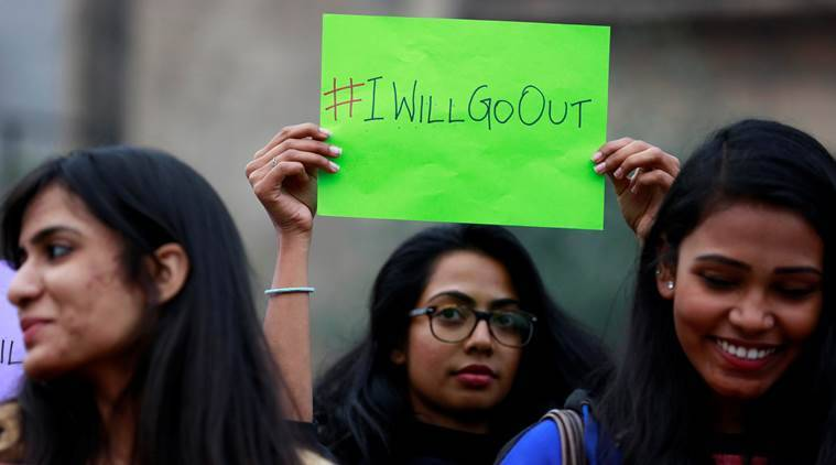Women wait for the start of the #IWillGoOut rally, organized to show solidarity with the Women's March in Washington, along a street in New Delhi, India January 21, 2017. REUTERS/Cathal McNaughton
