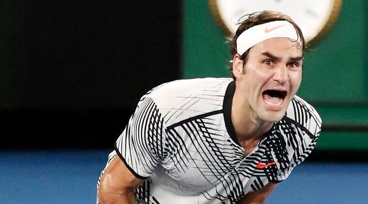 Switzerland's Roger Federer celebrates after defeating Spain's Rafael Nadal during the men's singles final at the Australian Open tennis championships in Melbourne, Australia, Sunday, Jan. 29, 2017. (AP Photo/Aaron Favila)