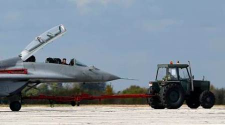 FILE - In this Thursday Oct. 13, 2016 file photo, ground crew prepare a MiG 29 fighter jet for a flight during the joint Russian-Serbian military exercises BARS (Brotherhood of Aviators of Russia and Serbia) 2016, at the military airport Batajnica, near Belgrade, Serbia. Serbian Prime Minister Aleksandar Vucic secured a deal on his visit to Russia on Wednesday Dec. 21, 2016, that Russia will supply Serbia with fighter jets, tanks and combat vehicles strengthening Moscow's influence in the Balkans. (AP Photo/Darko Vojinovic, File)