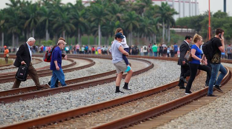 People exit the airport perimeter following a shooting incident at Fort Lauderdale-Hollywood International Airport in Fort Lauderdale, Florida, U.S. January 6, 2017. REUTERS/Andrew Innerarity