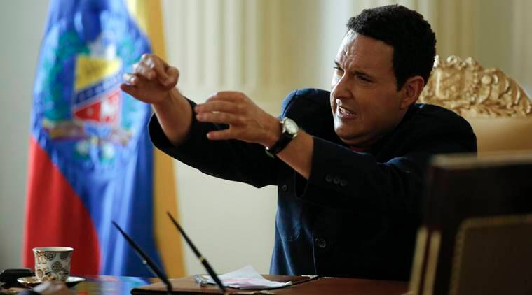 In this Jan. 25, 2017 photo, Colombia's actor Andres Parra plays the role of Venezuela's former President Hugo Chavez during the filming of