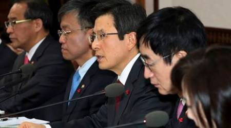 South Korea's acting leader, Prime Minister Hwang Kyo-ahn, center, speaks during a Cabinet meeting at the government complex in Seoul, South Korea, Tuesday, Jan. 10, 2017. Hwang said Tuesday that Seoul, Tokyo and others involved in the issue must respect the deal's spirits and try to work together to boost bilateral ties. (Baek Seung-ryul/Yonhap via AP)