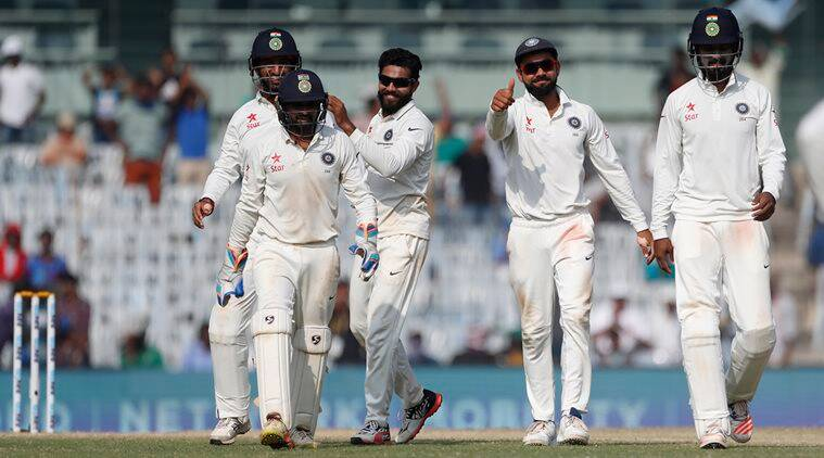 India's captain Virat Kohli, second right, Ravindra Jadeja, center, and teammates celebrate the dismissal of England's Moeen Ali during their fifth day of the fifth cricket test match in Chennai, India, Tuesday, Dec. 20, 2016. (AP Photo/Tsering Topgyal)