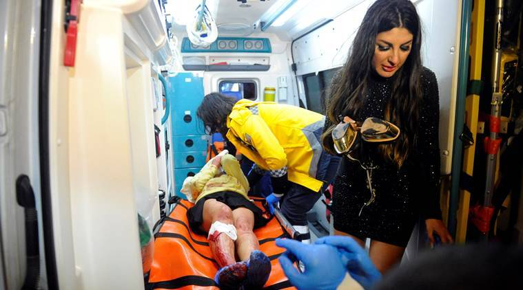 An injured woman is carried to an ambulance from a nightclub where a gun attack took place during a New Year party in Istanbul, Turkey. Murat Ergin/Ihlas News Agency via Reuters