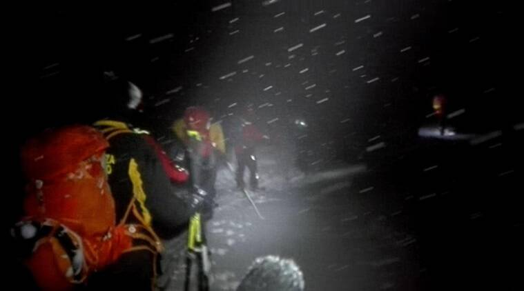 Rescuers make their way to the hotel hit by an avalanche in Farindola, Italy, early Thursday, Jan. 19, 2017. A hotel in the mountainous region hit again by quakes has been covered by an avalanche, with reports of dead. Italian media say the avalanche covered the three-story hotel in the central region of Abruzzo, on Wednesday evening. (Italian Finance Police via AP)