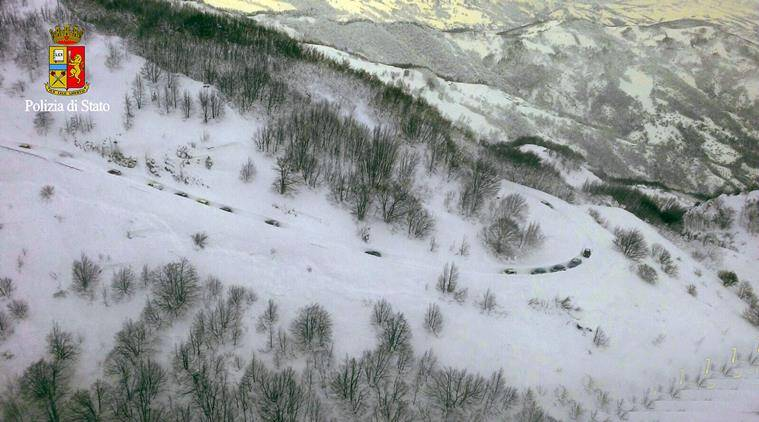 Rescue vehicles make their way to the hotel hit by an avalanche in Farindola, Italy, early Thursday, Jan. 19, 2017. A hotel in the mountainous region hit again by quakes has been covered by an avalanche, with reports of dead. Italian media say the avalanche covered the three-story hotel in the central region of Abruzzo, on Wednesday evening. (Italian Police via AP)