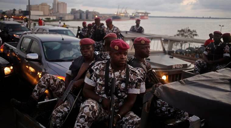 FILE-In this file photo taken Friday, Oct. 23, 2015, Ivory Coast troops provide security during an election rally of Ivory Coast incumbent President Alassane Ouattara in Abidjan, Ivory Coast.  Some unidentified soldiers have launched mutinies in three cities across this West African country on Friday, Jan. 6, 2017, demanding higher pay and bringing the threat of unrest back to Africa's fastest-growing economy, authorities said. (AP Photo/Schalk van Zuydam, File)