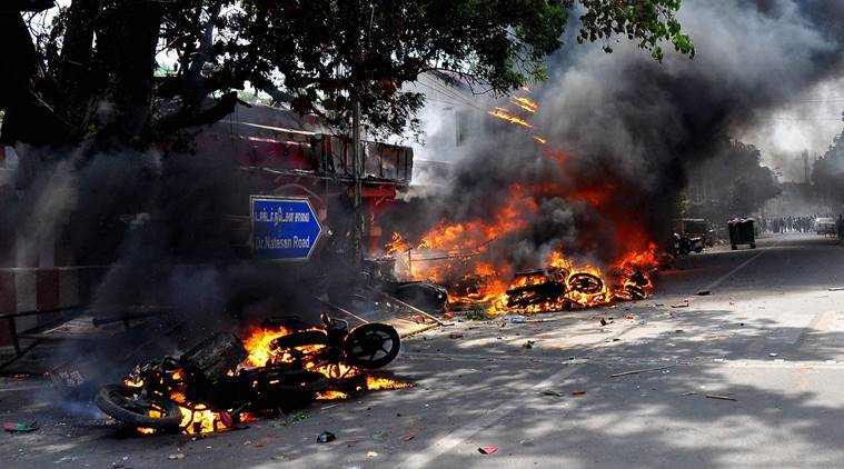 Chennai: Two wheelers suspected to be set on fire by protestors go up in flames in Chennai on Monday. Fans of Jallikattu, a traditional bull-taming ritual attacked a police station with stones and set some vehicles on fire Monday in anger at being forcibly evicted from the beach where they have been protesting for the past week in support of the sport. PTI Photo BY R Senthil Kumar(PTI1_23_2017_000306B)
