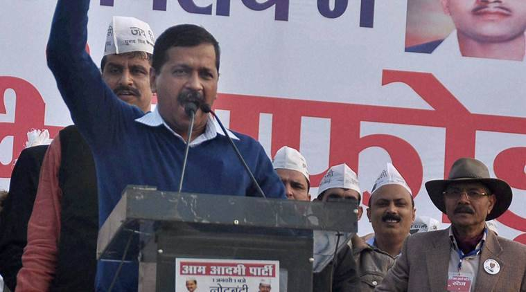 AAP chief and Delhi CM Arvind Kejriwal addressing at a party rally in Rohtak on Sunday (PTI Photo)