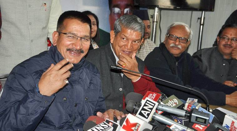Dehradun: Uttarakhand Congress chief Kishore Upadhyay along with the state CM Harish Rawat during a press conference at party headquarters in Dehradun on Tuesday. PTI Photo(PTI1_17_2017_000168B) *** Local Caption ***
