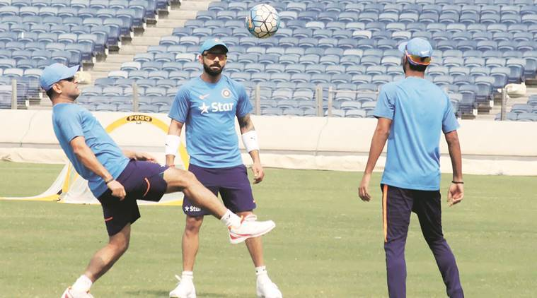 Kohli and Dhoni during a training session in Pune on Tuesday. PTI