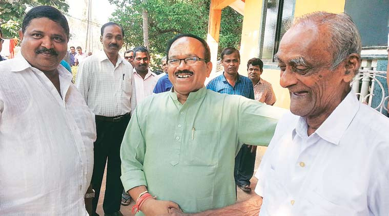 Laxmikant Parsekar with supporters at Arambol, in his constituency of Mandrem. (Express Photo by Zeeshan Sheikh)