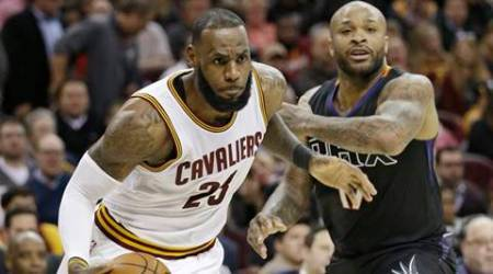 Cleveland Cavaliers' LeBron James, left, drives against Phoenix Suns' P.J. Tucker in the second half of an NBA basketball game, Thursday, Jan. 19, 2017, in Cleveland. The Cavaliers won 118-103.(AP Photo/Tony Dejak)