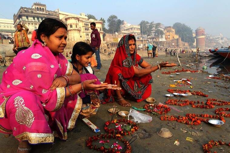 Devotee women perform Makar Sankranti Puja after taking a holy dip in Ganga river at the Assi Ghat in Varanasi. Express Photo by Anand Singh.