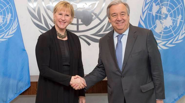 In this photo provided by the United Nations, U.N. Secretary-General Antonio Guterres, right, and Sweden's Minister for Foreign Affairs Margot Wallstrom pose for a handshake during their meeting at U.N. headquarters. (Eskinder Debebe, United Nations via AP)