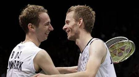 Denmark's Mathias Boe and his teammate Carsten Mogensen celebrate winning their men's doubles badminton semifinal match against South Korea's Lee Yong-dae and Chung Jae-sung at the London 2012 Olympic Games at the Wembley Arena