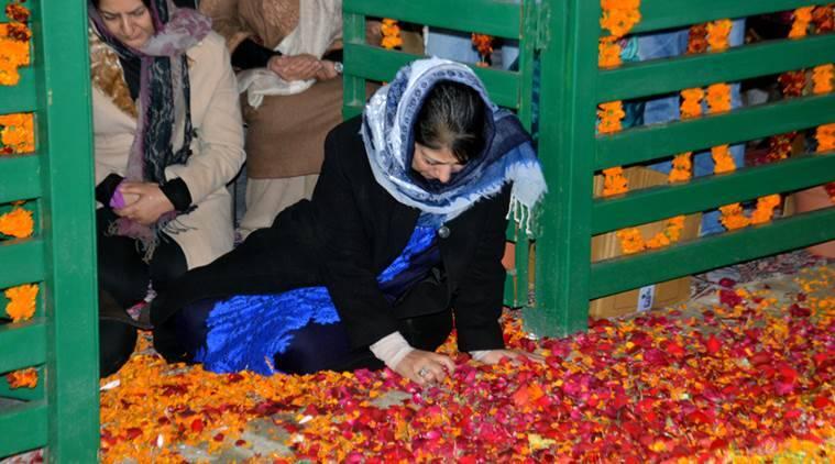 Jammu and Kashmir Chief Minister Mehbooba Mufti on Saturday offered prayers at her father Mufti Muhammad Sayeed`s grave on his first death anniversary.Mehbooba visited the grave in Bijbehara town in Anantnag district.Express Photo by Shuaib Masoodi 07-01-2017