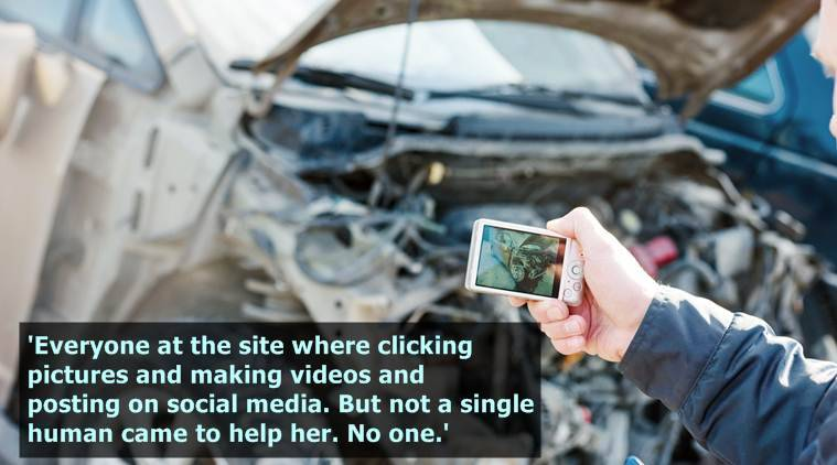 Insurance agent photographing damage after car crash during inspecting damaged automobile for claim form