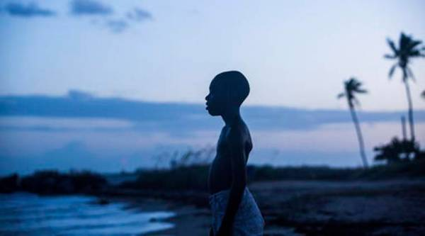 "This image released by A24 Films shows Alex Hibbert in a scene from the film, ""Moonlight."" Nominees for the 89th Academy Awards will be announced on Tuesday, Jan. 24, 2017.  (David Bornfriend/A24 via AP)"