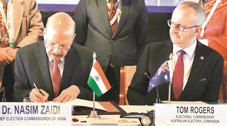 CEC Nasim Zaidi signs an MoU with Australian Election Commission in New Delhi on Tuesday. PTI